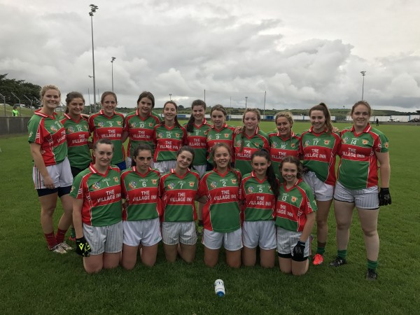 Intermediate Ladies Footballers up against strong opposition