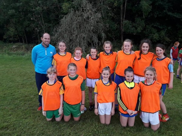 Clooney Quin Players and Mentors in U12 inter county football action